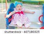Happy Little Girl On Swing.