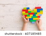 top  view  on child's hands... | Shutterstock . vector #607185485