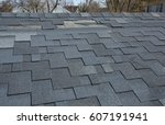Small photo of A close up view of shingles a roof damage. Roof Shingles - Roofing.