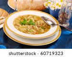 traditional polish tripe soup with vegetables on white plate - stock photo