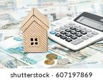 a cardboard house  a calculator ... | Shutterstock . vector #607197869