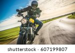 motorbike on the road riding.... | Shutterstock . vector #607199807