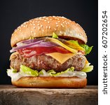 fresh tasty burger on wooden... | Shutterstock . vector #607202654