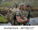 Bow Hunter On A River Stream...