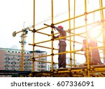 Construction Workers Working O...