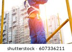 construction workers working on ... | Shutterstock . vector #607336211