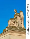 Small photo of Allegory statue of Victorious France, near the Arc de Triomphe du Carrousel, Paris and part of Louvre museum