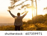 man raise hand up in the air... | Shutterstock . vector #607359971