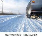 Snowy Winter Road Behind An...