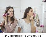 happy young women makeup in the ... | Shutterstock . vector #607385771