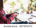 asian woman using tablet on... | Shutterstock . vector #607391471