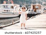 smiling baby girl 1 2 year old... | Shutterstock . vector #607425257