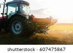 tractor spreading artificial... | Shutterstock . vector #607475867
