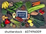Small photo of Alkaline foods above the wooden background