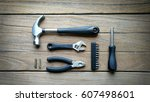 group of tools on wood... | Shutterstock . vector #607498601
