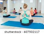 women making yoga meditation in ...   Shutterstock . vector #607502117