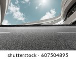 asphalt road and modern... | Shutterstock . vector #607504895