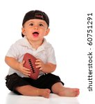 An Adorable Baby Boy Holding A...