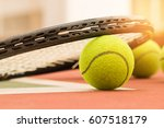 tennis ball with racket on the... | Shutterstock . vector #607518179