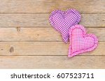 two pastel colored hearts on... | Shutterstock . vector #607523711