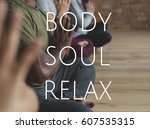 Small photo of Group of people training in yoga class for body soul and mind relief
