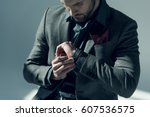 handsome stylish man adjusting... | Shutterstock . vector #607536575