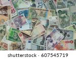 Stock photo currency of different countries background dollar euro poland russia uganda swiss 607545719