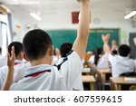 raised hands in class of middle ... | Shutterstock . vector #607559615