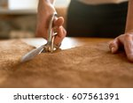 female artisan cutting brown... | Shutterstock . vector #607561391
