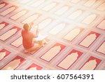religious muslim man praying... | Shutterstock . vector #607564391
