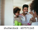 african american family washing ... | Shutterstock . vector #607571165