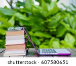 stack of books with laptop on... | Shutterstock . vector #607580651