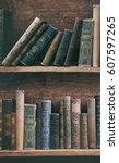 old books on wooden shelf. | Shutterstock . vector #607597265