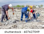 Small photo of Zrenjanin, Vojvodina, Serbia - April 30, 2015: Constructions workers are using jackhammer to realign reinforced pillars in the ground.