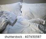 close up of messy bedding... | Shutterstock . vector #607650587
