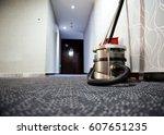 vacuum cleaner stands in the... | Shutterstock . vector #607651235