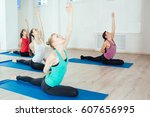 group women are practicing yoga ... | Shutterstock . vector #607656995