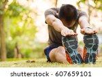 close up young man runner warm... | Shutterstock . vector #607659101