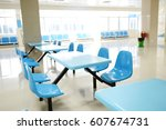 Stock photo clean school cafeteria with many empty seats and tables 607674731