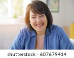 portrait of smiling 50 year old ... | Shutterstock . vector #607679414