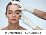facial treatment. portrait of... | Shutterstock . vector #607680935