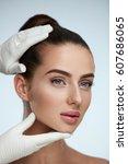 facial beauty. portrait of... | Shutterstock . vector #607686065