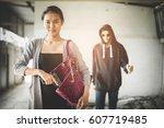 woman pulls a gun from her... | Shutterstock . vector #607719485