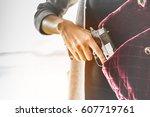 woman pulls a gun from her... | Shutterstock . vector #607719761