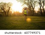 young man jogging at the park  | Shutterstock . vector #607749371