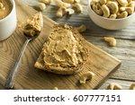 homemade cashew peanut butter... | Shutterstock . vector #607777151