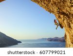 young woman climbing... | Shutterstock . vector #607799021
