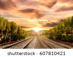 by the train as the sun | Shutterstock . vector #607810421