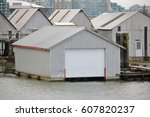 A Large  Metal Boathouse Has...