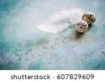 white feather and quail eggs on ... | Shutterstock . vector #607829609